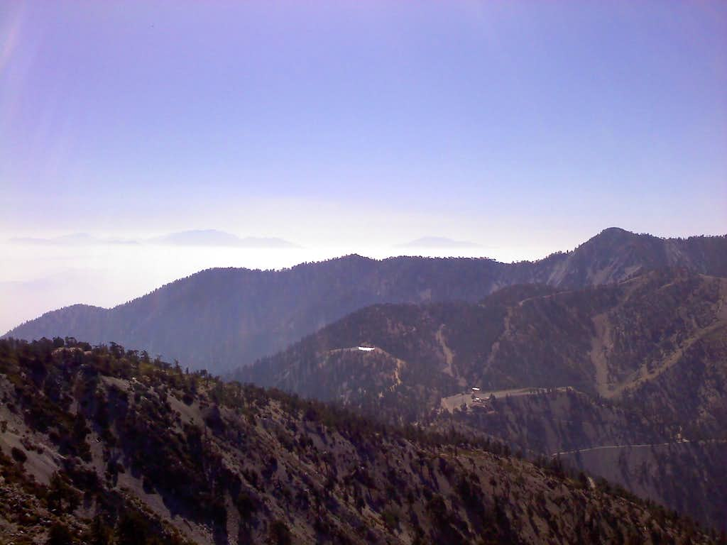 Looking ESE... San Gorgonio is poking through the clouds on the left, San Jacinto on the right
