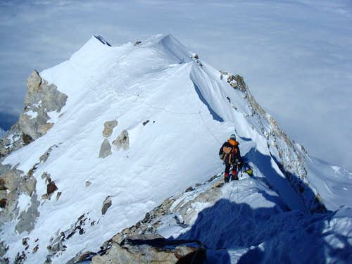 Makalu: Mick Parker climbing down the summit ridge