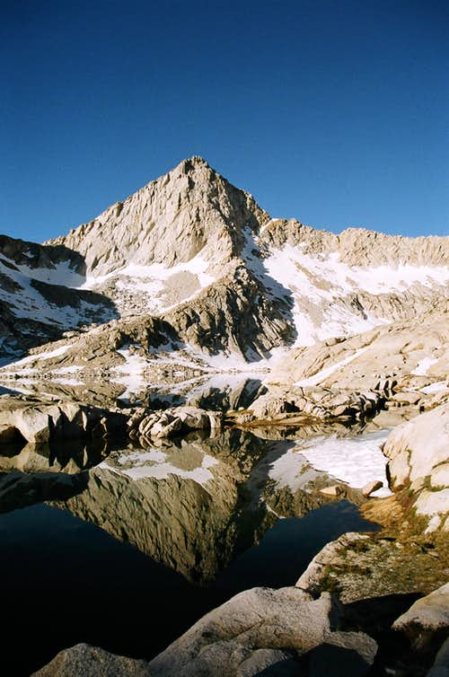 Columbine Lake\'s reflection of Sawtooth Peak, early morning