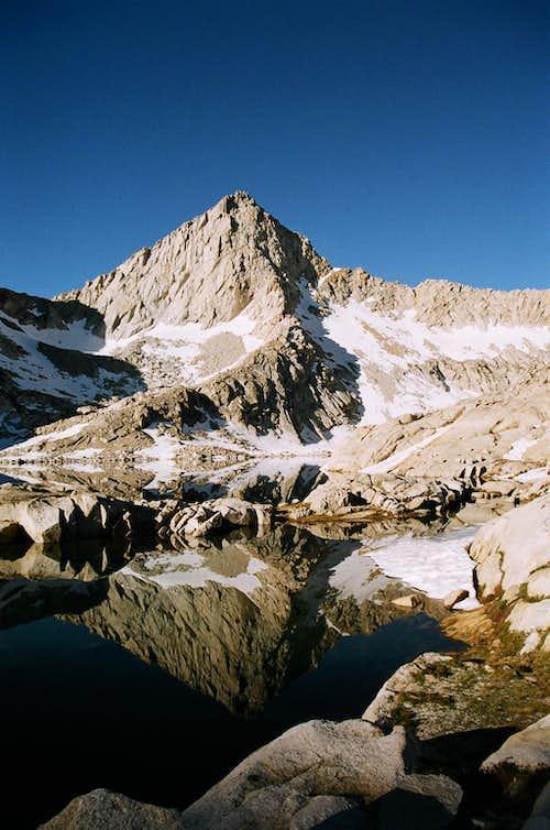 Columbine Lake's reflection of Sawtooth Peak, early morning
