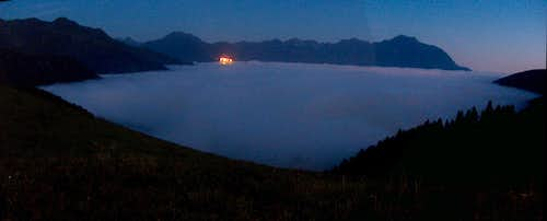 Nocturn panorama over a sea of clouds from Col d'Azet