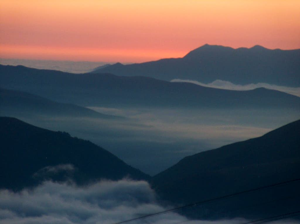 Aea of clouds at sunrise, looking East to the Louron and Luchon valleys