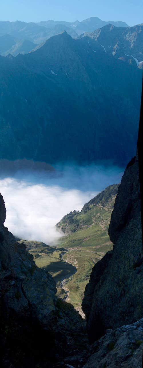 The cloudy Vallon de La Pez while ascending Pic d'Estos