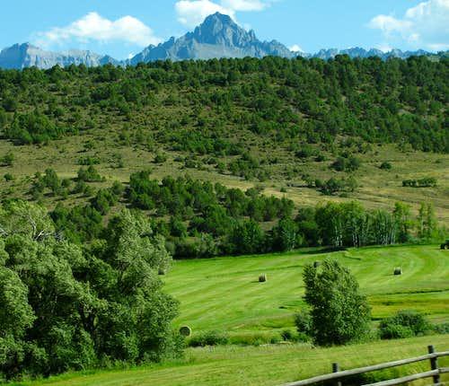 Mount Sneffels over hayfields