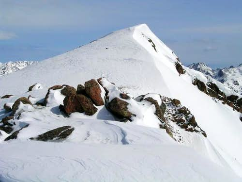 The corniced summit of Point...