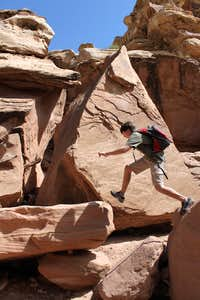 jumping across boulders