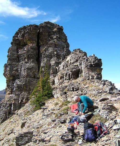 Preparing to climb the true summit tower on Heavy Runner Mountain