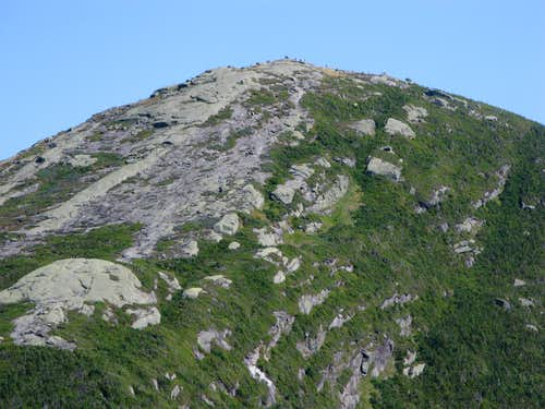 The summit block of Mt. Marcy with hikers on top