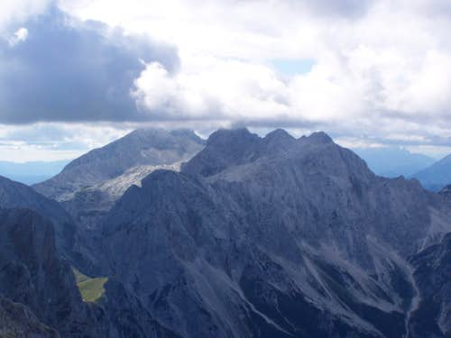 The peak of Skuta in clouds. Grintovec in the background