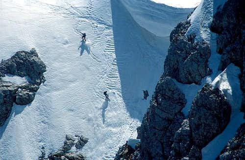 Two skiers descending the...