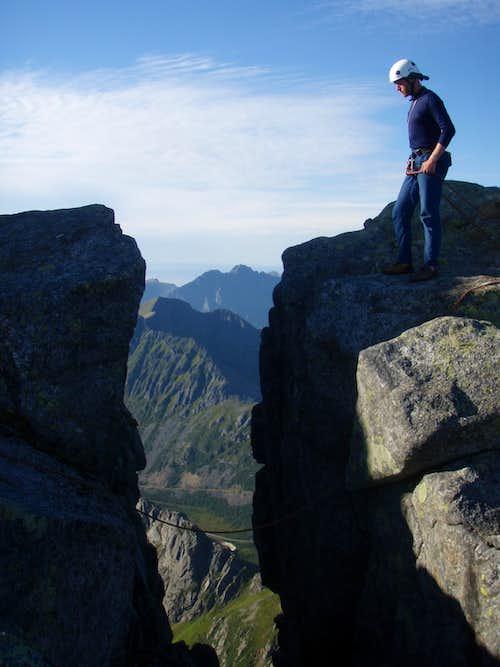 Mike contemplates the jump.  Vagakellen, Lofoten