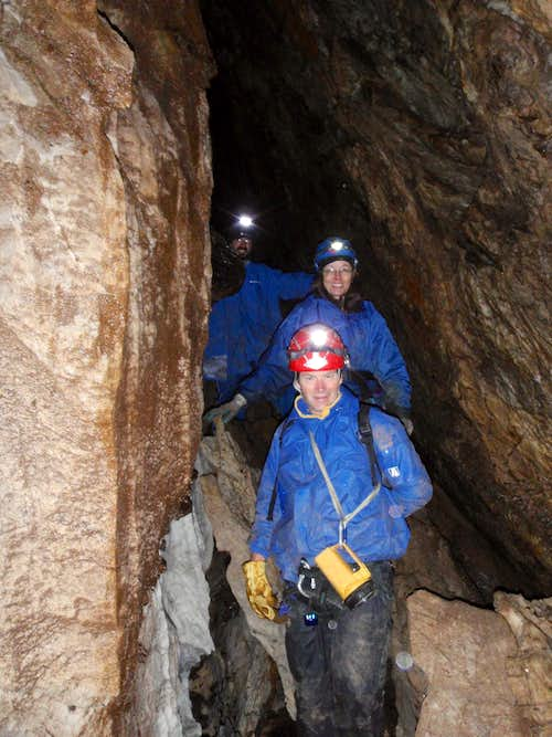 Three Cavers In Blue