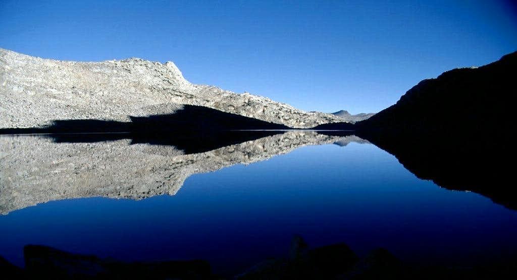 Goethe Lake reflecting Muriel Peak's shadow