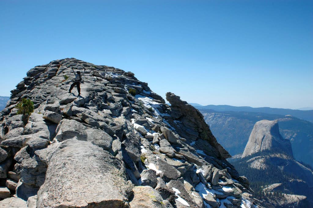 Excited to be on Clouds Rest, Half Dome in the background