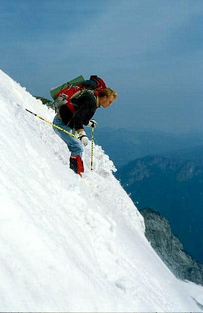 Skiing down the steep east...