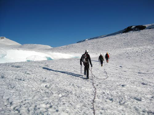 Walking around a crevasse on saddle of Rainier
