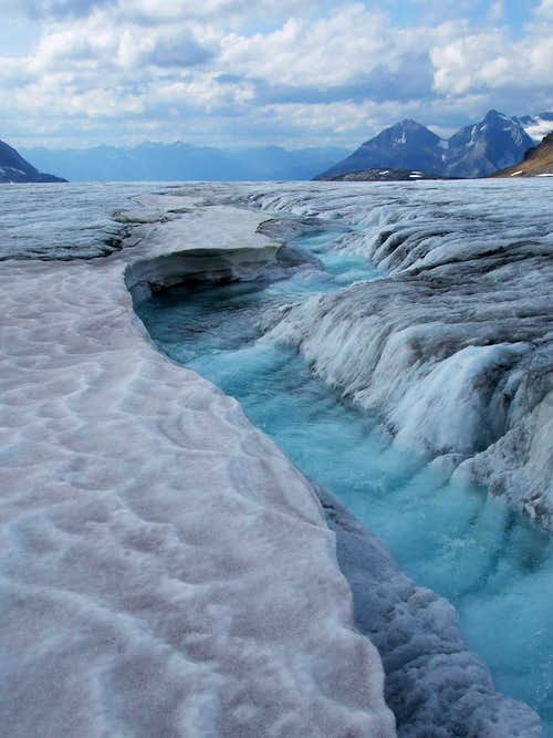 Ethereal blue stream on the Kitchi Icefield.