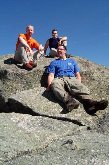 Group on summit boulder