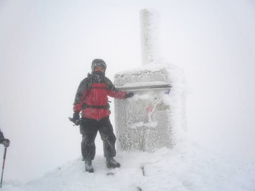 Summit in winter conditions
