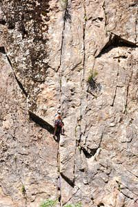 climber on the first pitch