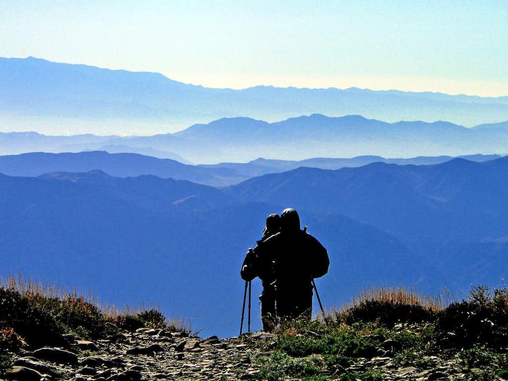 Hikers cresting the Panamint Range at dawn