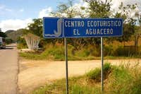 Sign to El Aguacero from the highway