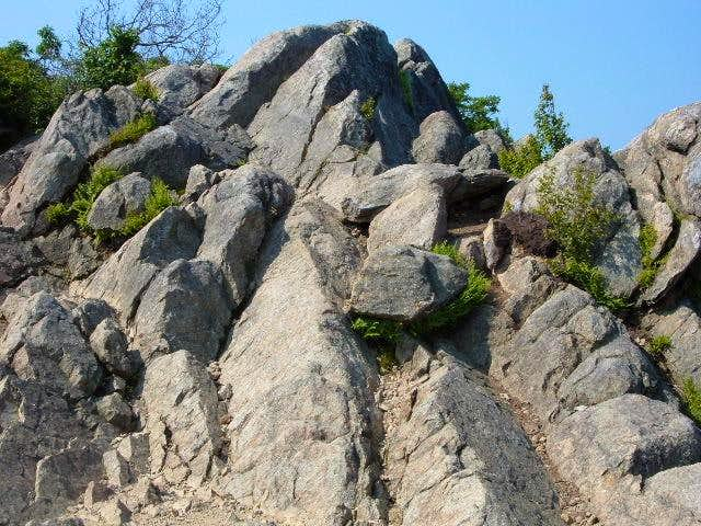 This rock is not the summit....
