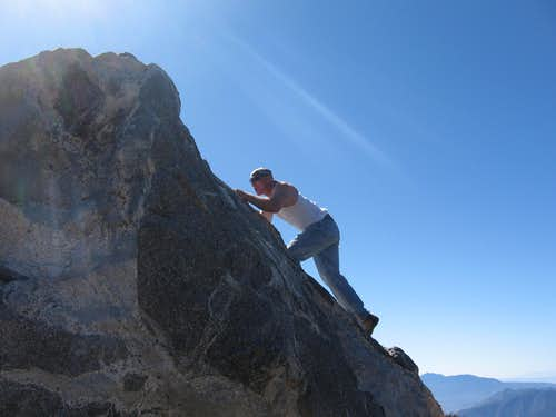 Iron Mike climbing up Cornell's summit