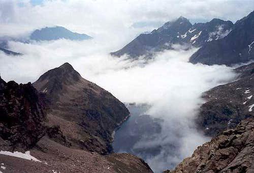 Summit view to cloudy Cap de Long lake