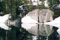 A calm reflection pool en...