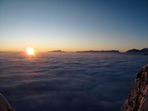 The sun rising above the fog