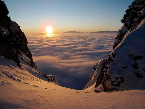 Sunset and sunrise above the clouds on the Untersberg