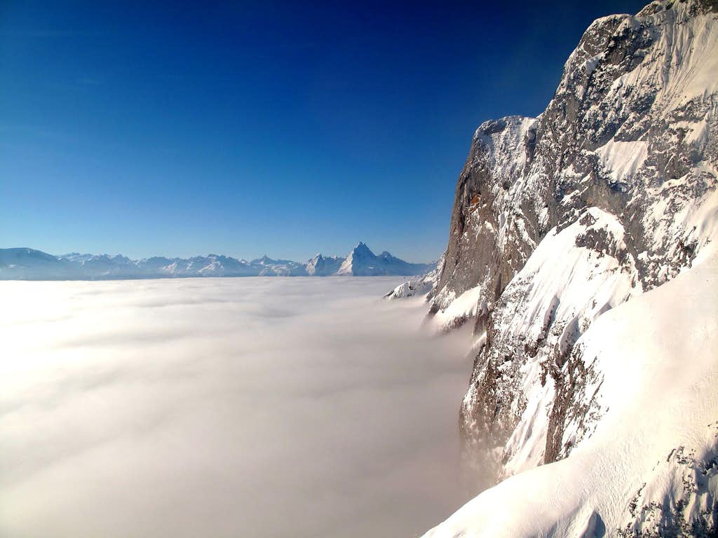 The east wall of the Untersberg rising out of the fog, with Steinernes Meer and Watzmann in the background