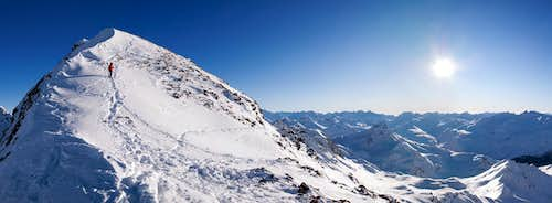 Panorama - Piz d\'Agnel, sun and mountain climber