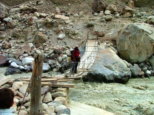 Trekker crossing the bridge