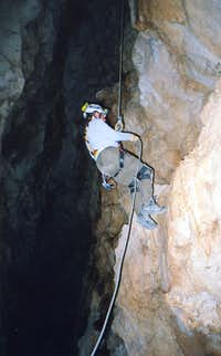 Rappelling into Ogle Cave