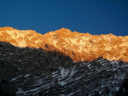 The west wall of the Watzmann in the beginning alpine glow
