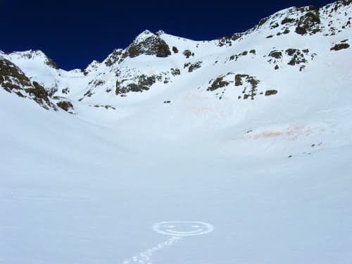 Smiley marks the trail