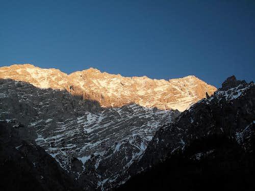 The Watzmann west wall and it's three summits Hocheck (2651m), Watzmann main summit (2713m) and south summit (2713m) in the evening light