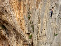 a friend climbing in the arhi sector on kalymnos.Great slabs next to the cave.