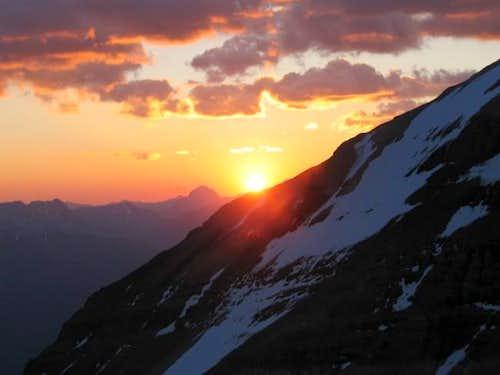 The sun peaking over Mount...