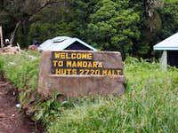 Mandara Huts Sign