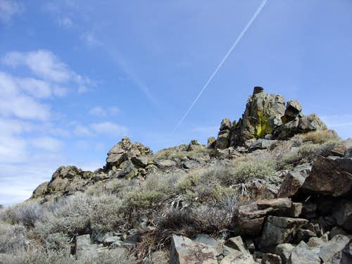 Looking up to the summit rocks