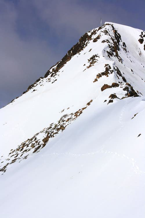 Snowy summit ridge