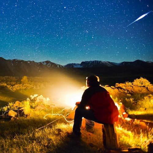 Campfire under the night sky