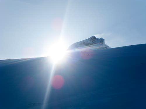 The sun peeking over Colfax