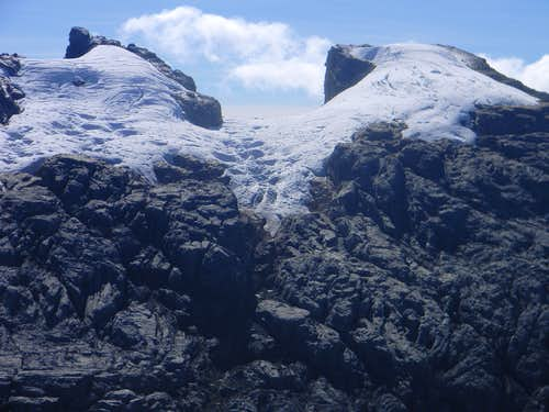 Sumantri (left) and Puncak Jaya (right) from the slopes of Carstensz Pyramid