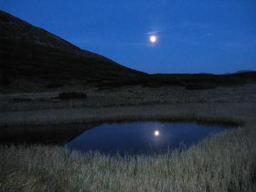 Full moon reflecting in a tarn