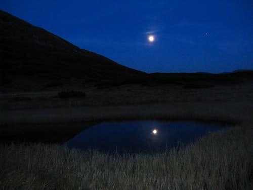 Full moon reflecting in a tarn