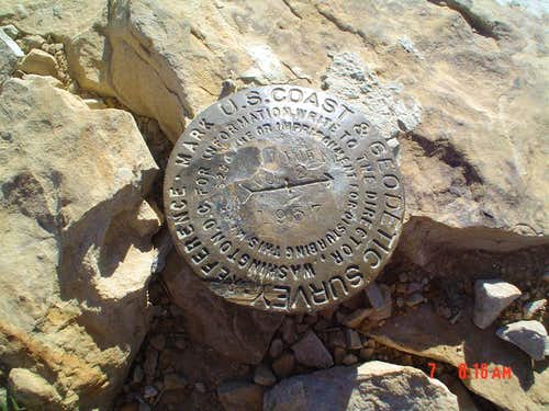Survey marker at the summit